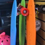 Brightly colored skateboards against wall